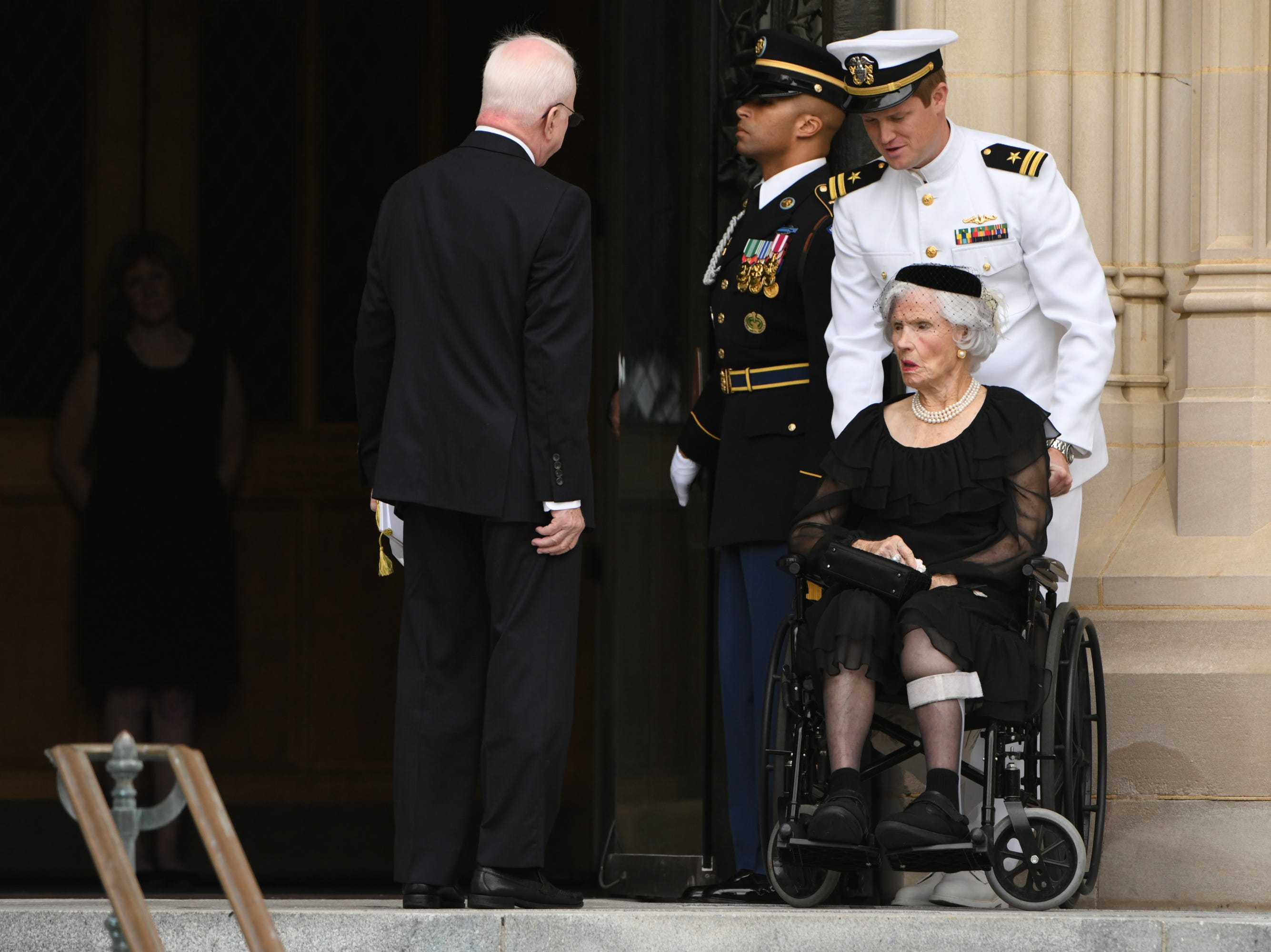 John McCain's mother Roberta McCain leaves the memorial service for her son at the National Cathedral.