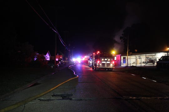 Fire trucks lined up on Jones Street early Sunday as firefighters fought a blaze at Skip Converse Inc. Crews were at the scene for about eight hours.