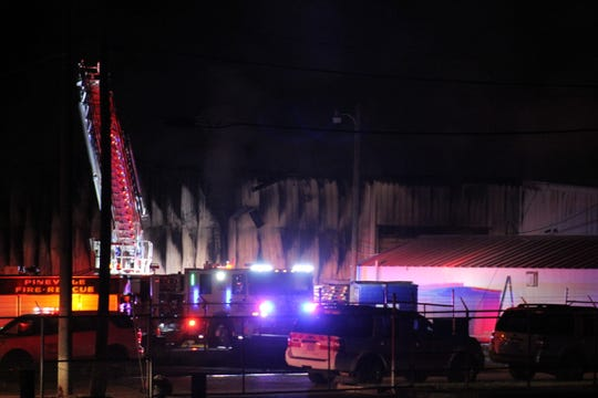 Fire damage can be seen on a metal storage building at Skip Converse Inc. in Pineville. Part of complex of the general contractor was destroyed in the fire, which was reported Saturday night and burned into Sunday.