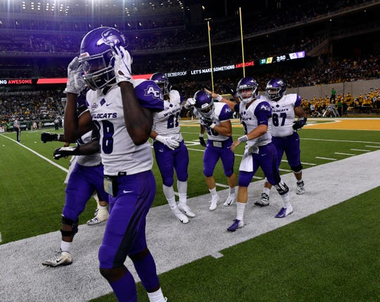 ACU teammates congratulate running back Billy McCrary after his 75-yard touchdown run against Baylor on Saturday in Waco. It was the Cal transfer's first collegiate touchdown.