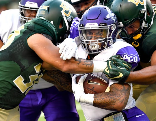 Abilene Christian running back Tracy James is surrounded by Baylor defenders during the Wildcats' game Sept. 1, 2018, in Waco.