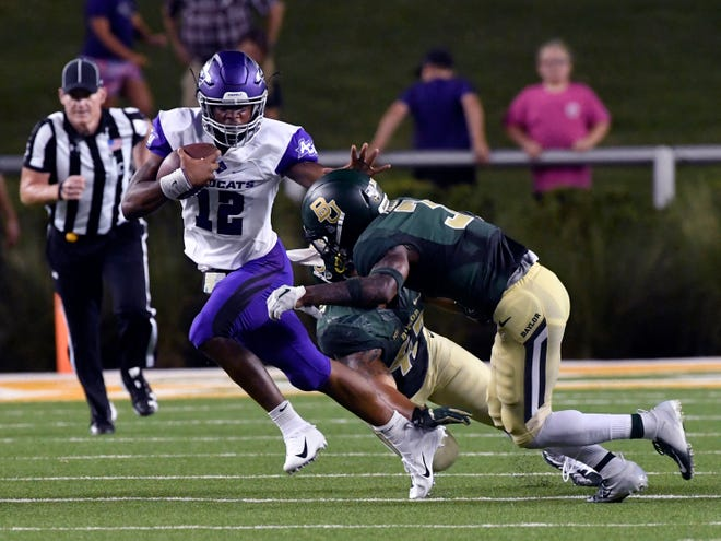 ACU quarterback Sema'J Davis tries to dodge the Baylor defense during last season's game in Waco.