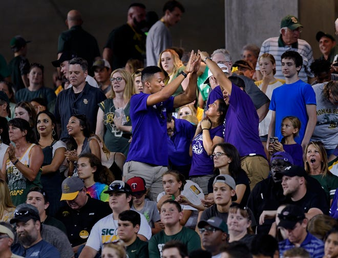 Abilene Christian University fans celebrate a Wildcats touchdown during Saturday's game against Baylor in Waco. ACU scored three TDs in a 55-27 loss to the Bears in the first meeting between the two Texas schools.