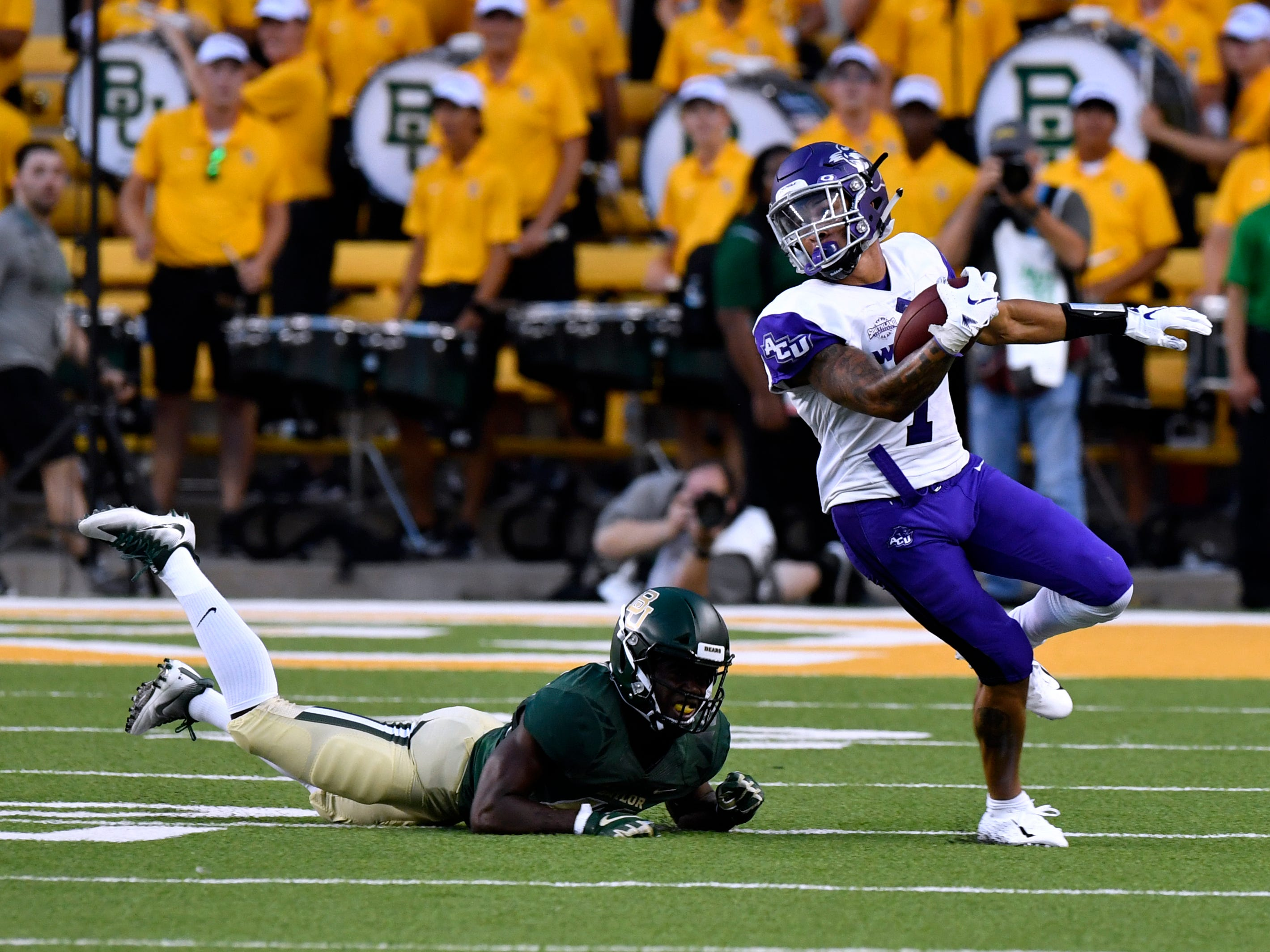 ACU wide receiver D.J. Fuller escapes a tackle during Saturday's game against Baylor in Waco Sept. 1, 2018.