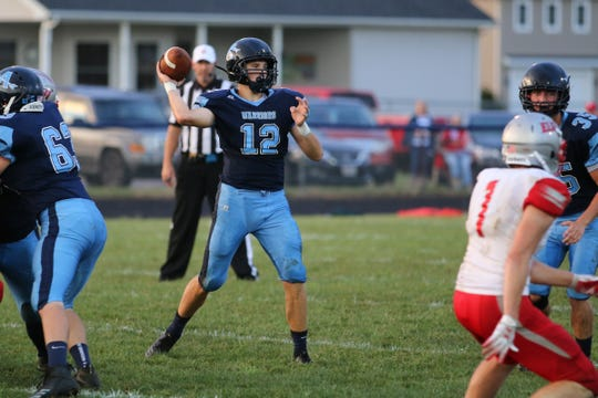 Adena's Preston Sykes throws a pass against Marion Elgin.