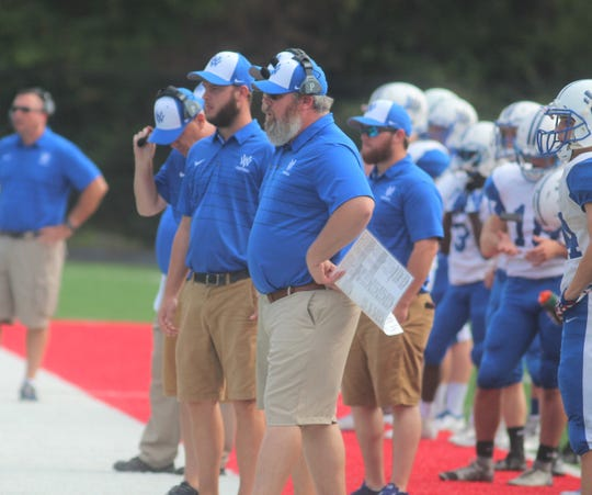 Walton-Verona head coach Jeff Barth, foreground, watches his team during Walton-Verona's 48-0 win over Holmes Sept. 1 at Holmes High School. The game concluded on Saturday morning after being suspended at halftime because of weather.