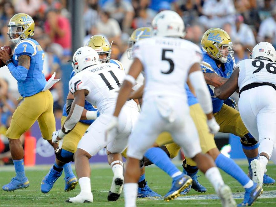 UCLA Bruins quarterback Dorian Thompson-Robinson (7) moves out to pass against the Cincinnati Bearcats during the second half at the Rose Bowl. Mandatory Credit: Gary A. Vasquez-USA TODAY Sports