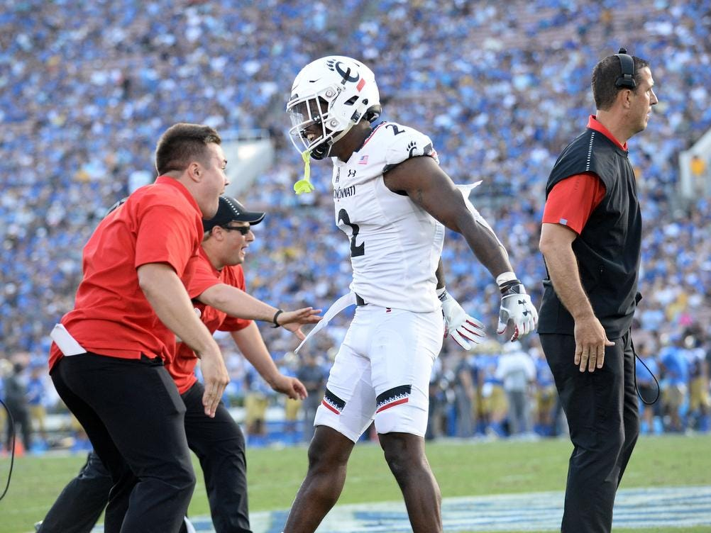 Cincinnati Bearcats cornerback Tyrell Gilbert (2) celebrates following a safety scored by the defense against the UCLA Bruins during the second half at the Rose Bowl. Mandatory Credit: Gary A. Vasquez-USA TODAY Sports