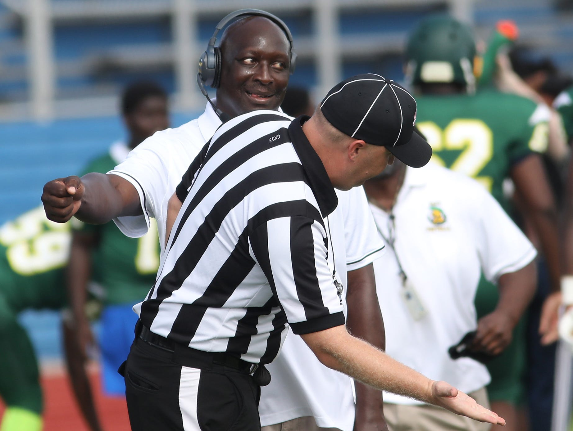 Taft head coach Jeff Cargile talks with the referee during the  Senators' 14-12 loss to Wyoming , Saturday, Sept. 1, 2018.