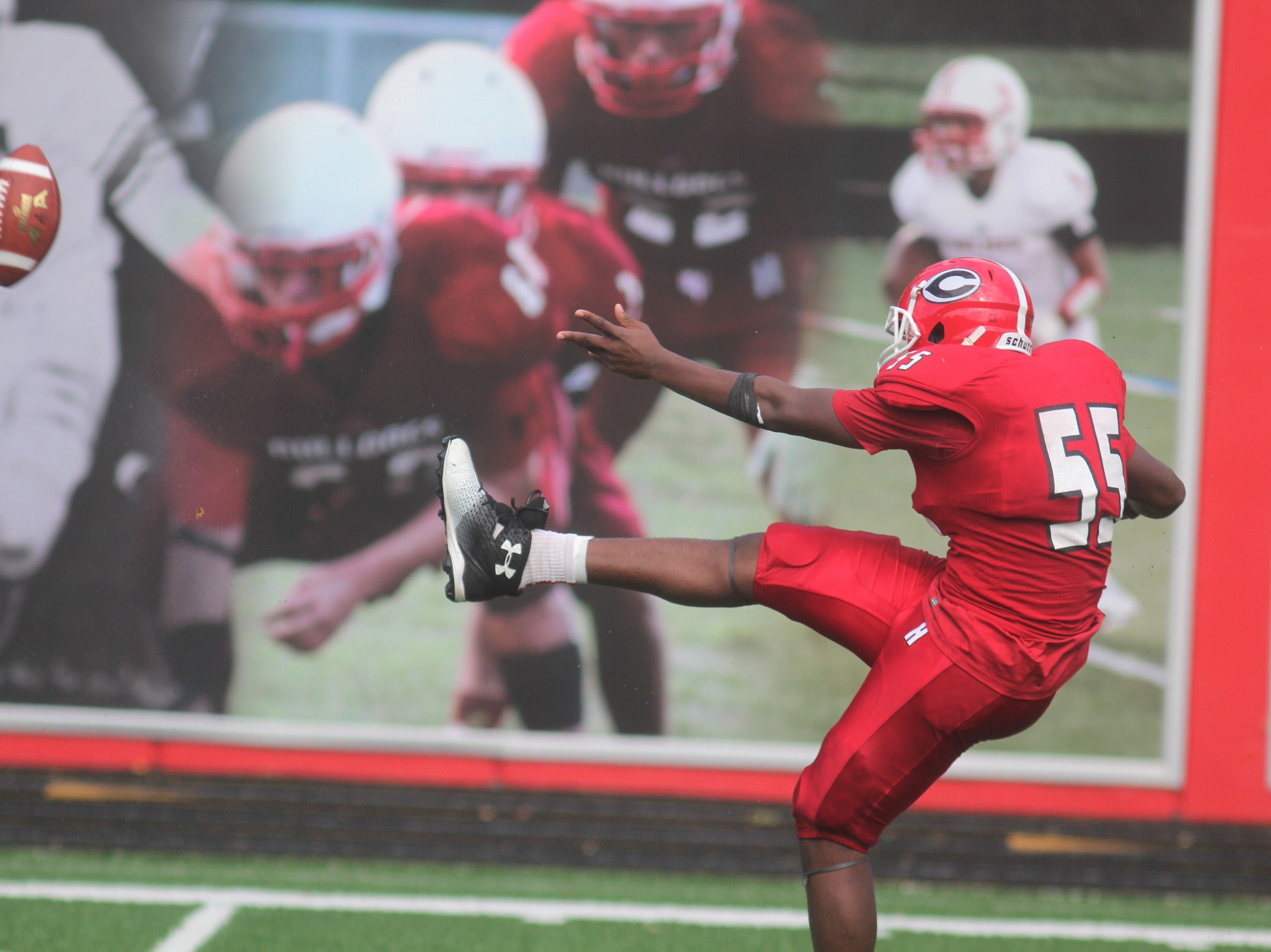 Holmes punter unleashes a kick during Walton-Verona's 48-0 win over Holmes Sept. 1 at Holmes High School. The game concluded on Saturday morning after being suspended at halftime because of weather.