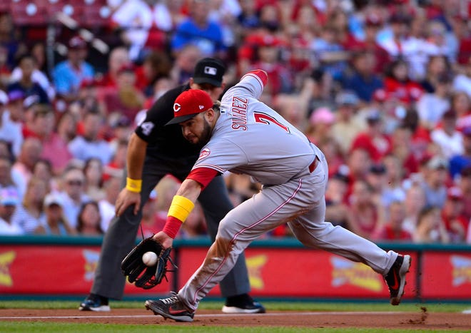 Sep 1, 2018; St. Louis, MO, USA; Cincinnati Reds third baseman Eugenio Suarez (7) fields a ground ball hit by St. Louis Cardinals left fielder Tyler O'Neill (not pictured) during the second inning at Busch Stadium. Mandatory Credit: Jeff Curry-USA TODAY Sports