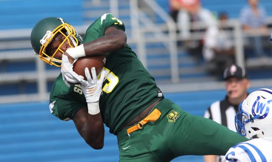 Taft's Chris' Seon Stringer catches a touchdown pass  during the Senators' 14-12 loss to  Wyoming , Saturday, Sept. 1, 2018.