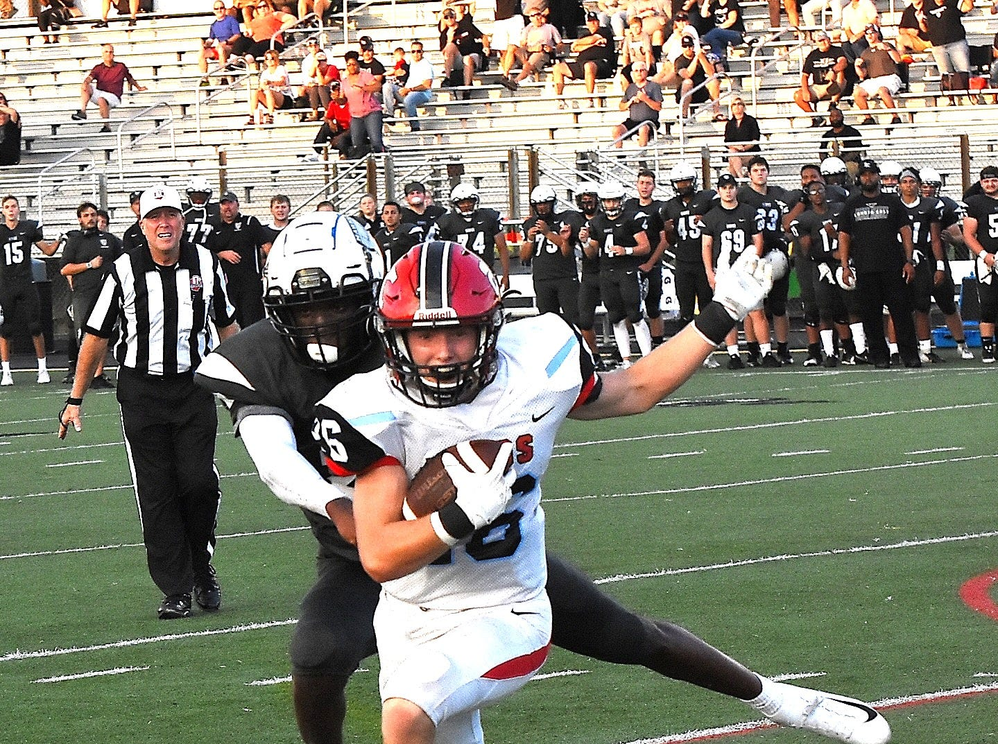 Kings' Ty Stylski breaks a Lakota East tackle and heads up field for a long Knights gain, Sept. 1, 2018.