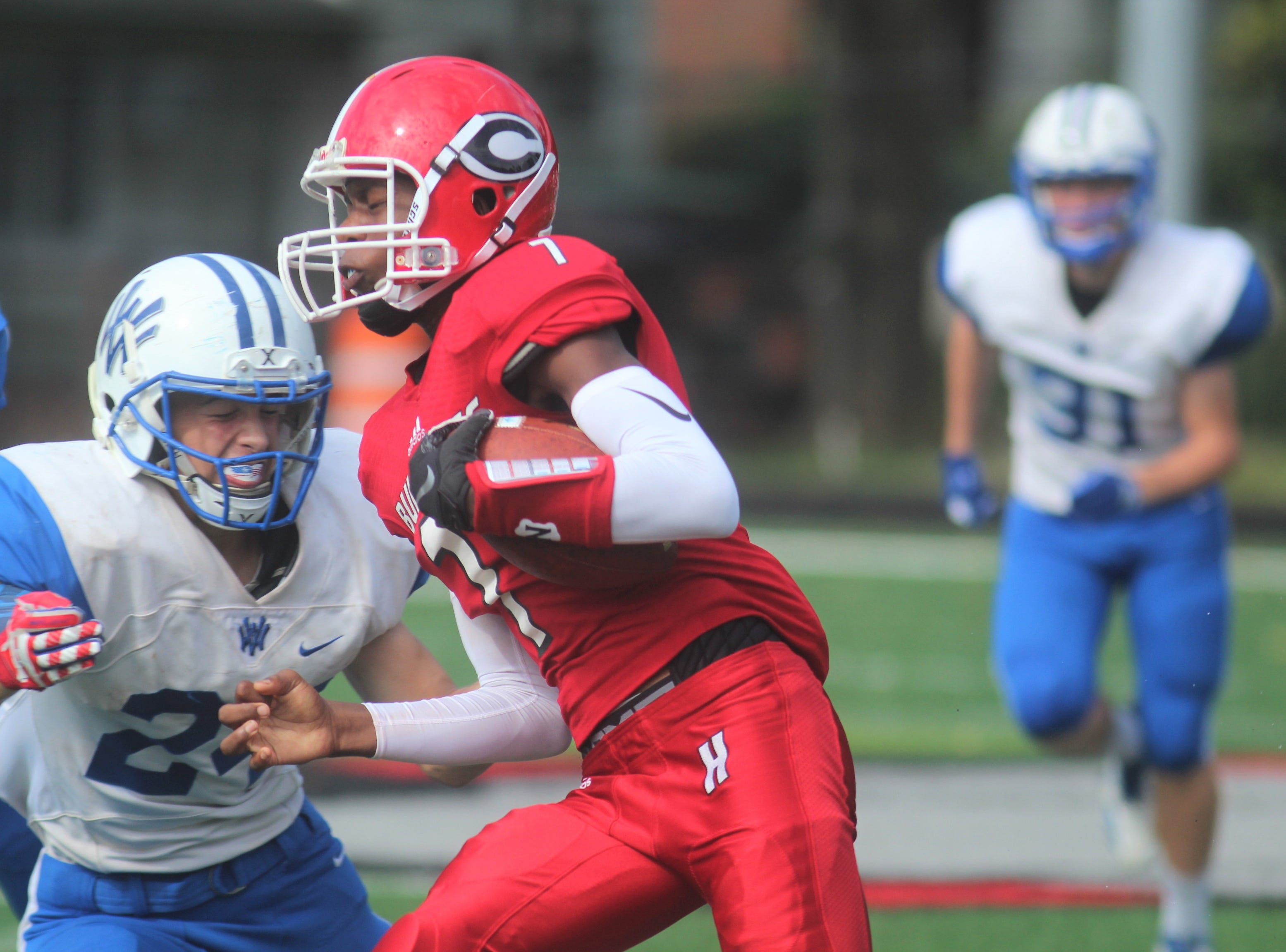Holmes junior Ben Girton runs upfield during Walton-Verona's 48-0 win over Holmes Sept. 1 at Holmes High School The game concluded on Saturday morning after being suspended at halftime because of weather.