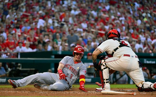 Sep 1, 2018; St. Louis, MO, USA; Cincinnati Reds second baseman Scooter Gennett (3) slides safely past St. Louis Cardinals catcher Yadier Molina (4) during the fourth inning at Busch Stadium. Mandatory Credit: Jeff Curry-USA TODAY Sports