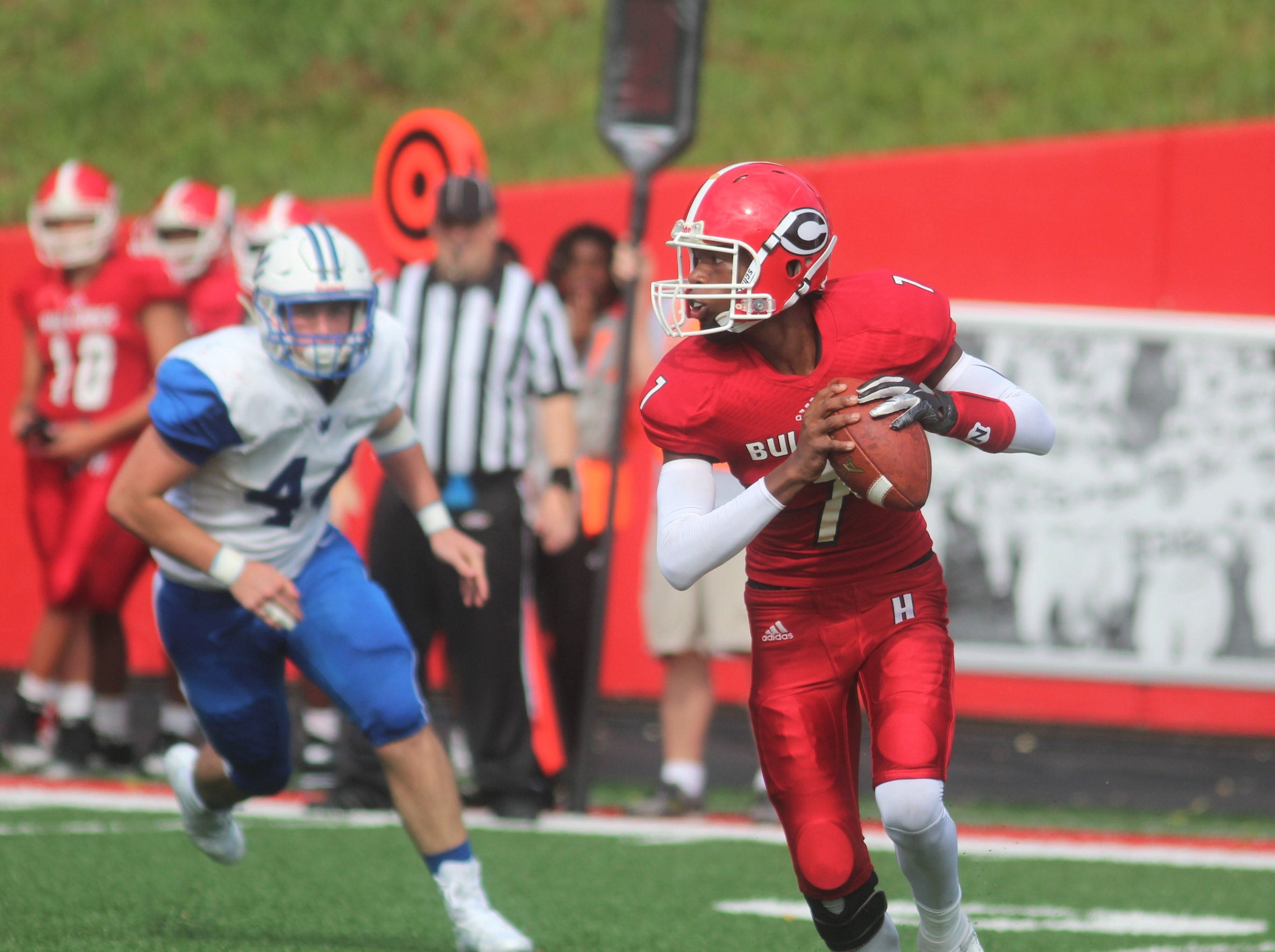 Holmes junior Ben Girton rolls out to pass during Walton-Verona's 48-0 win over Holmes Sept. 1 at Holmes High School The game concluded on Saturday morning after being suspended at halftime because of weather.