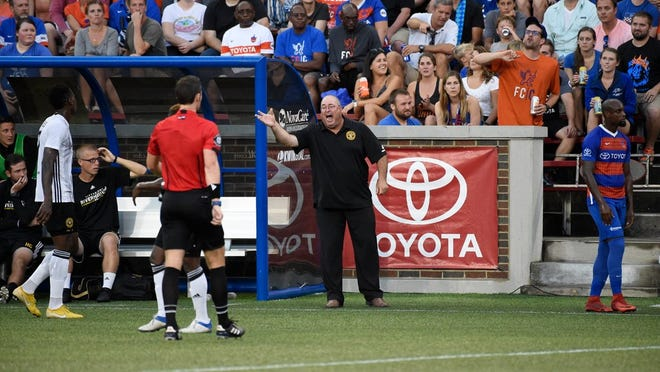 Pittsburgh Riverhounds SC head coach Bob Lilley yells at the match official in FC Cincinnati's 2-1 win over Pittsburgh at Nippert Stadium.