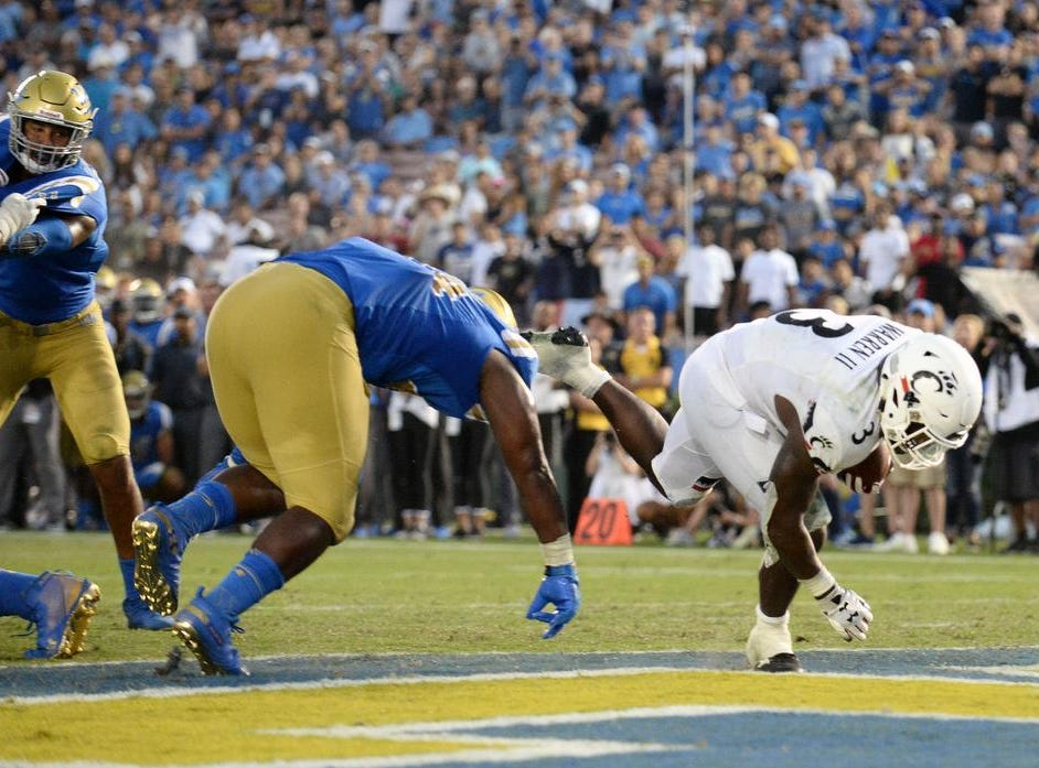 Cincinnati Bearcats running back Michael Warren II (3) moves the ball in for a touchdown against the UCLA Bruins during the second half at the Rose Bowl. Mandatory Credit: Gary A. Vasquez-USA TODAY Sports