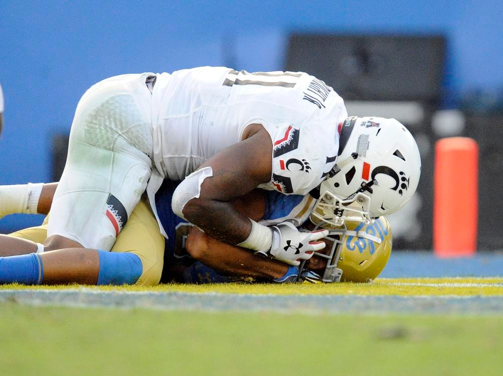 UCLA Bruins tight end Caleb Wilson (81) is brought down by Cincinnati Bearcats linebacker Bryan Wright (11) which results in a safety during the second half at the Rose Bowl. Mandatory Credit: Gary A. Vasquez-USA TODAY Sports