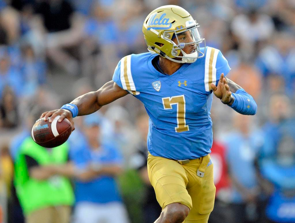 UCLA Bruins quarterback Dorian Thompson-Robinson (7) rolls out to pass against the Cincinnati Bearcats during the second half at the Rose Bowl. Mandatory Credit: Gary A. Vasquez-USA TODAY Sports