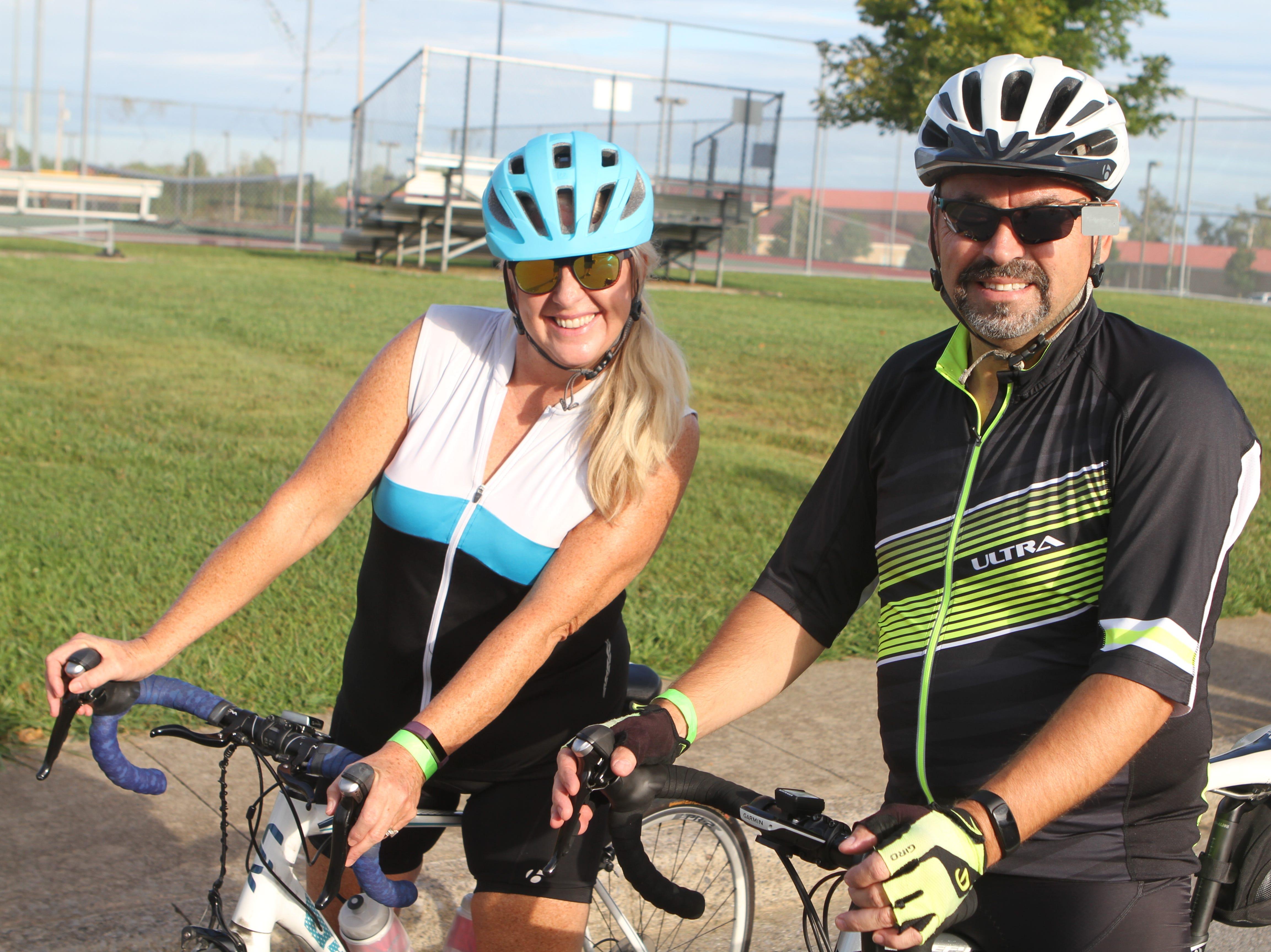 Anita Long and Tim Barker line up at the Sunrise Century Bike Ride Saturday.