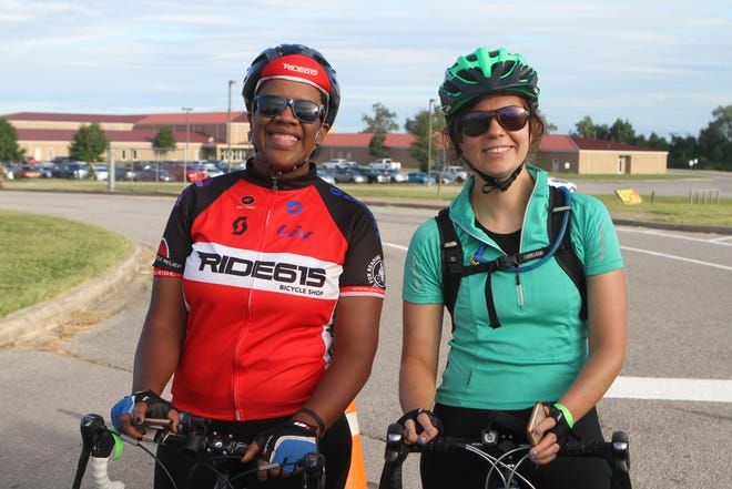 Danielle Young and Emma Banks line up at the Sunrise Century Bike Ride Saturday.