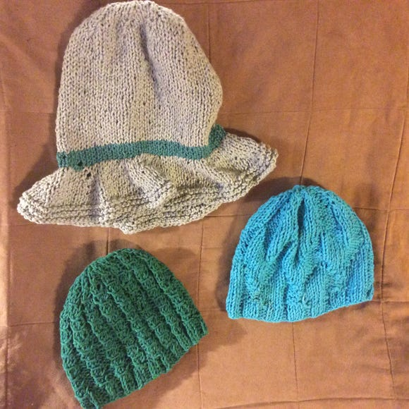 These are the last 3 chemo caps that I finished recently. The green one, which I made on size 9 needles, is a little bit airy. I should have used a thinner needle.