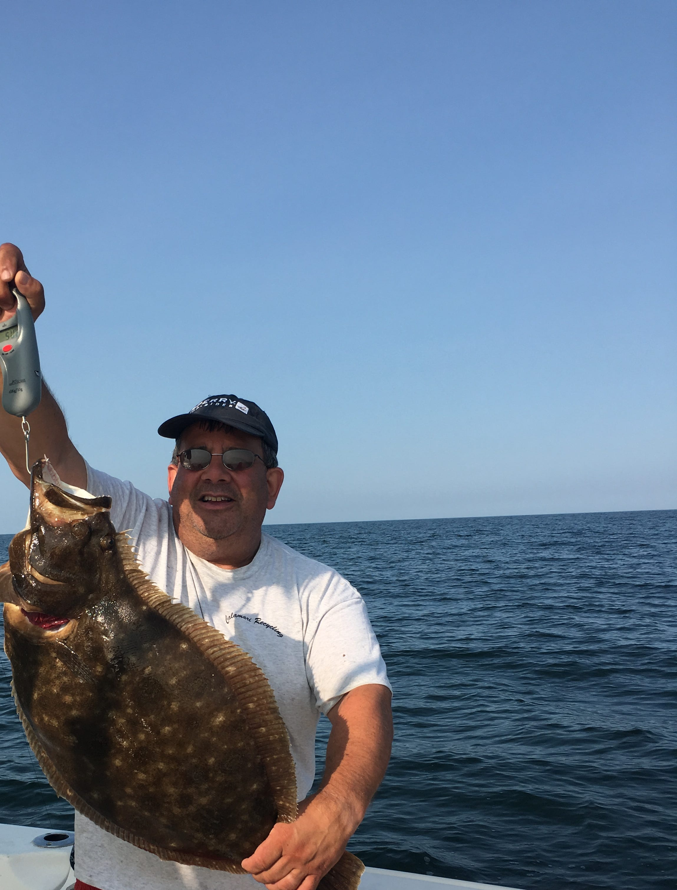 """Son-in Law Greg Morea holding the biggest fluke anyone in our family ever caught, a 11-1/4 lb. true """"Doormat"""", caught on the family boat, """"Sea Glass"""" out in Montauk."""