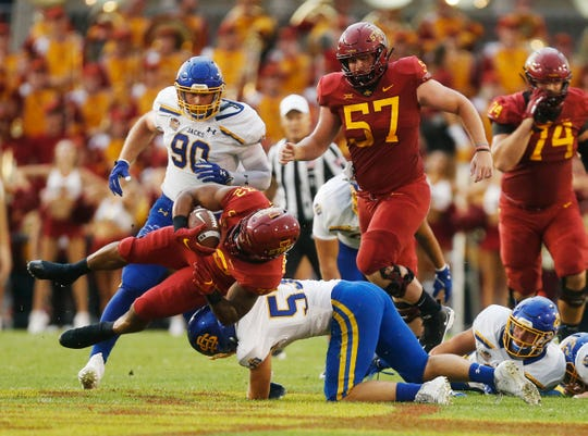 Iowa State running back David Montgomery (32) gets taken down by South Dakota State linebacker Dalton Cox (53) Saturday, Sept. 1, 2018, during their game at Jack Trice Stadium in Ames.