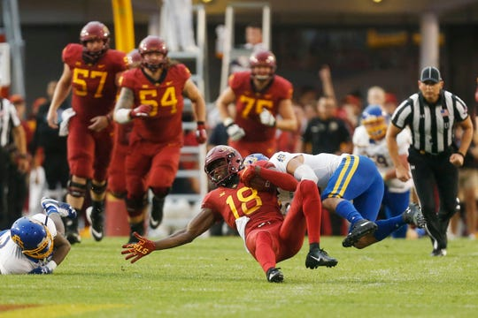 Iowa State wide receiver Hakeem Butler (18) gets brought down by a South Dakota State defender Saturday, Sept. 1, 2018, during their game at Jack Trice Stadium in Ames.