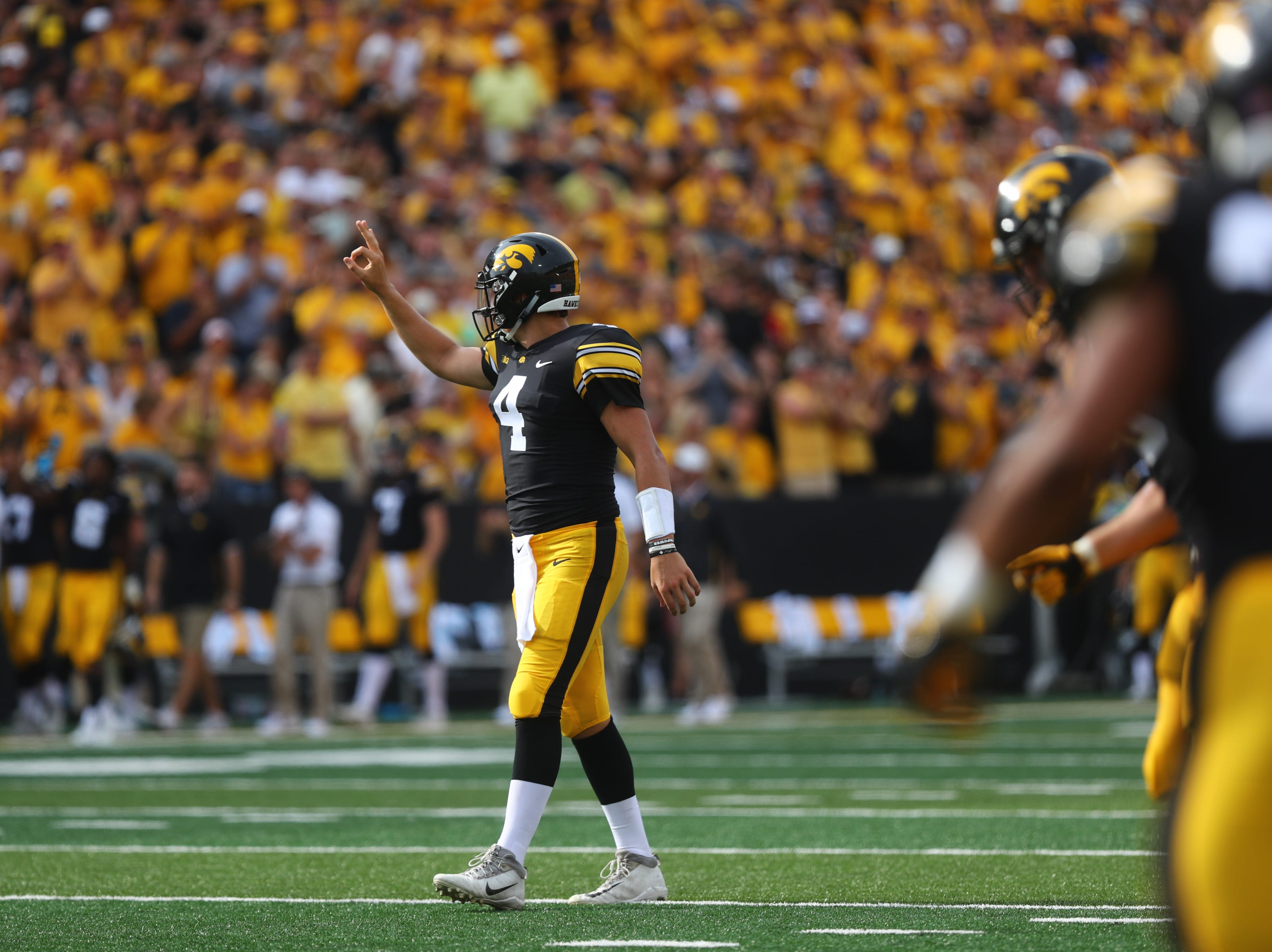 Iowa quarterback Nate Stanley sets up a play during the Hawkeyes' game against Northern Illinois at Kinnick Stadium on Satuday, Sept. 1, 2018.