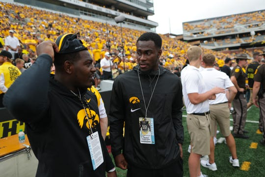 Former Hawkeyes Desmond King, left, and Josh Jackson chat before the Hawkeyes' game against Northern Illinois at Kinnick Stadium on Satuday, Sept. 1, 2018.
