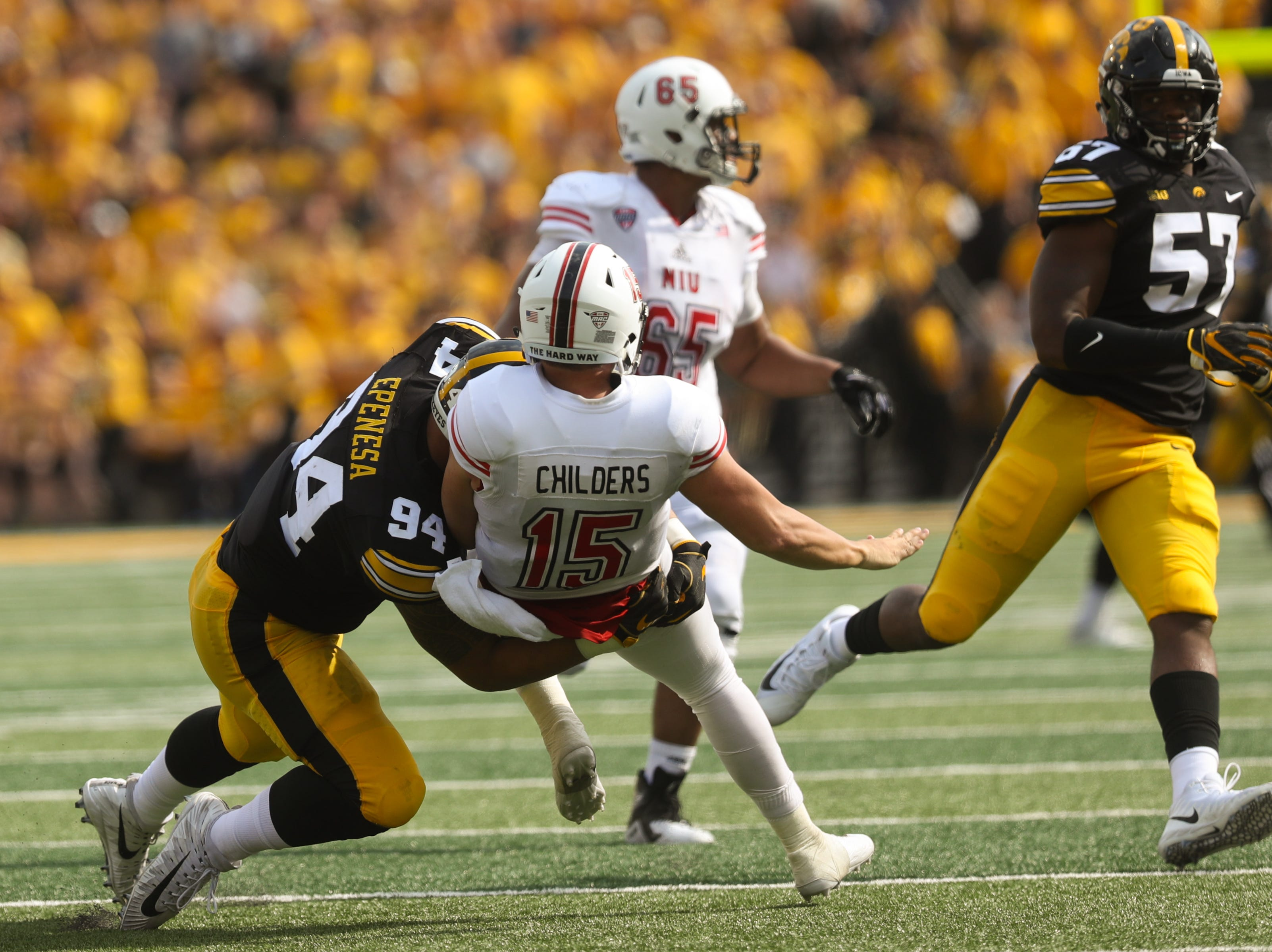 Iowa's A.J. Epenesa puts pressure on Northern Illinois quarterback Marcus Childers during their game at Kinnick Stadium on Satuday, Sept. 1, 2018.