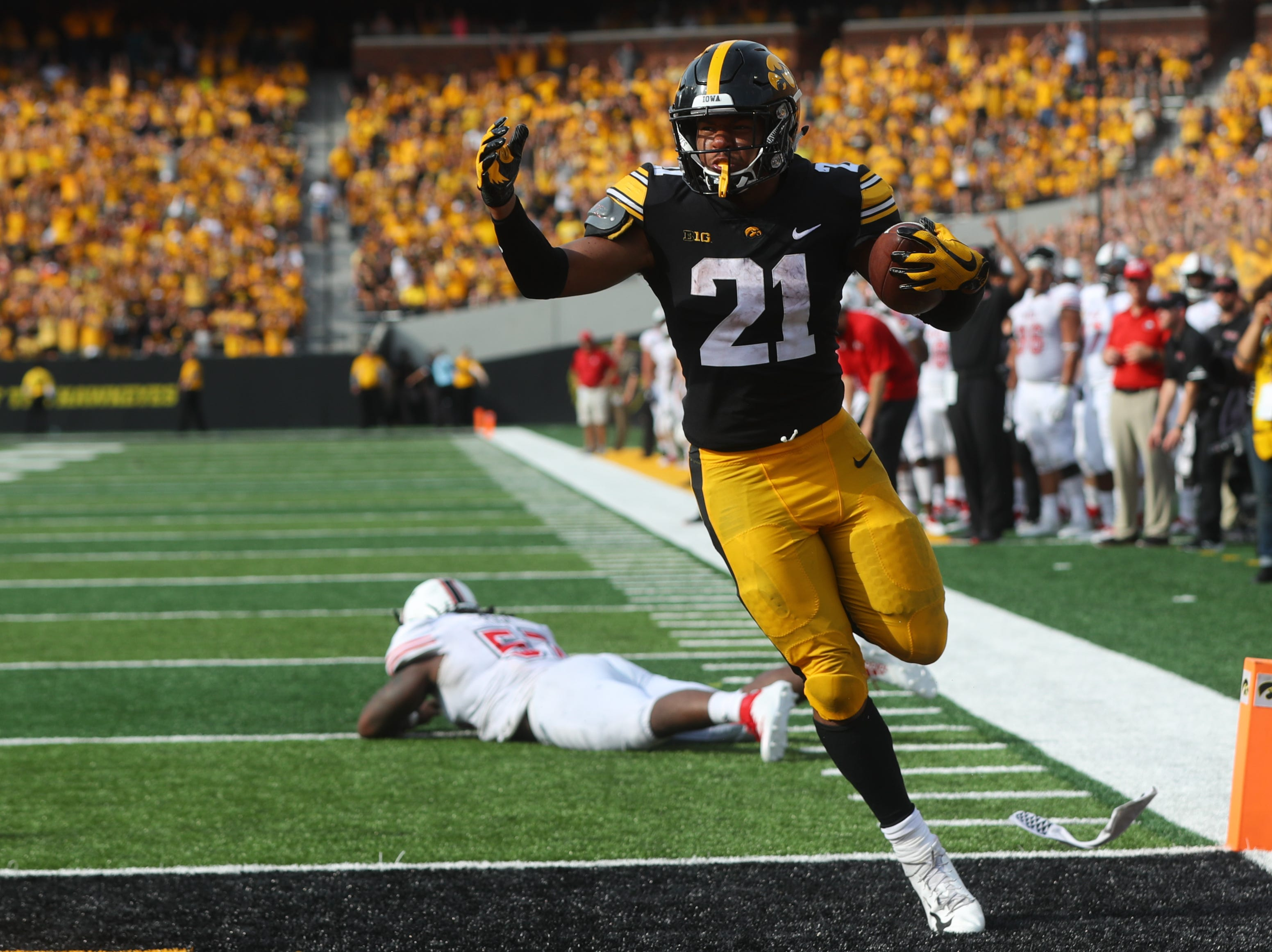 Iowa's Ivory Kelly-Martin runs in for a touchdown during the Hawkeyes' game against Northern Illinois at Kinnick Stadium on Satuday, Sept. 1, 2018.