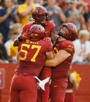 Iowa State outside lineman Colin Newell (57) and linebacker Kendrick Harris (56) lift up wide receiver Deshaunte Jones (8) after he scored a touchdown against South Dakota State Saturday, Sept. 1, 2018, during their game at Jack Trice Stadium in Ames.