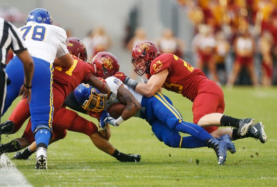 South Dakota State running back Isaac Wallace (35) gets taken down by  Iowa State defensive back Greg Eisworth (12) and Iowa State linebacker Mike Rose (23) Saturday, Sept. 1, 2018, during their game at Jack Trice Stadium in Ames.