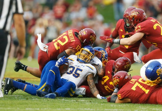 South Dakota State running back Isaac Wallace (35) gets brought down by a pack of Iowa State defenders Saturday, Sept. 1, 2018, during their game at Jack Trice Stadium in Ames.