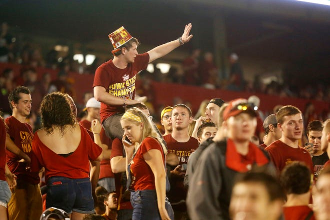 Fans in the student section try to entertain themselves as they wait out a weather delay Saturday, Sept. 1, 2018, during the Cyclones' game against South Dakota State at Jack Trice Stadium in Ames.