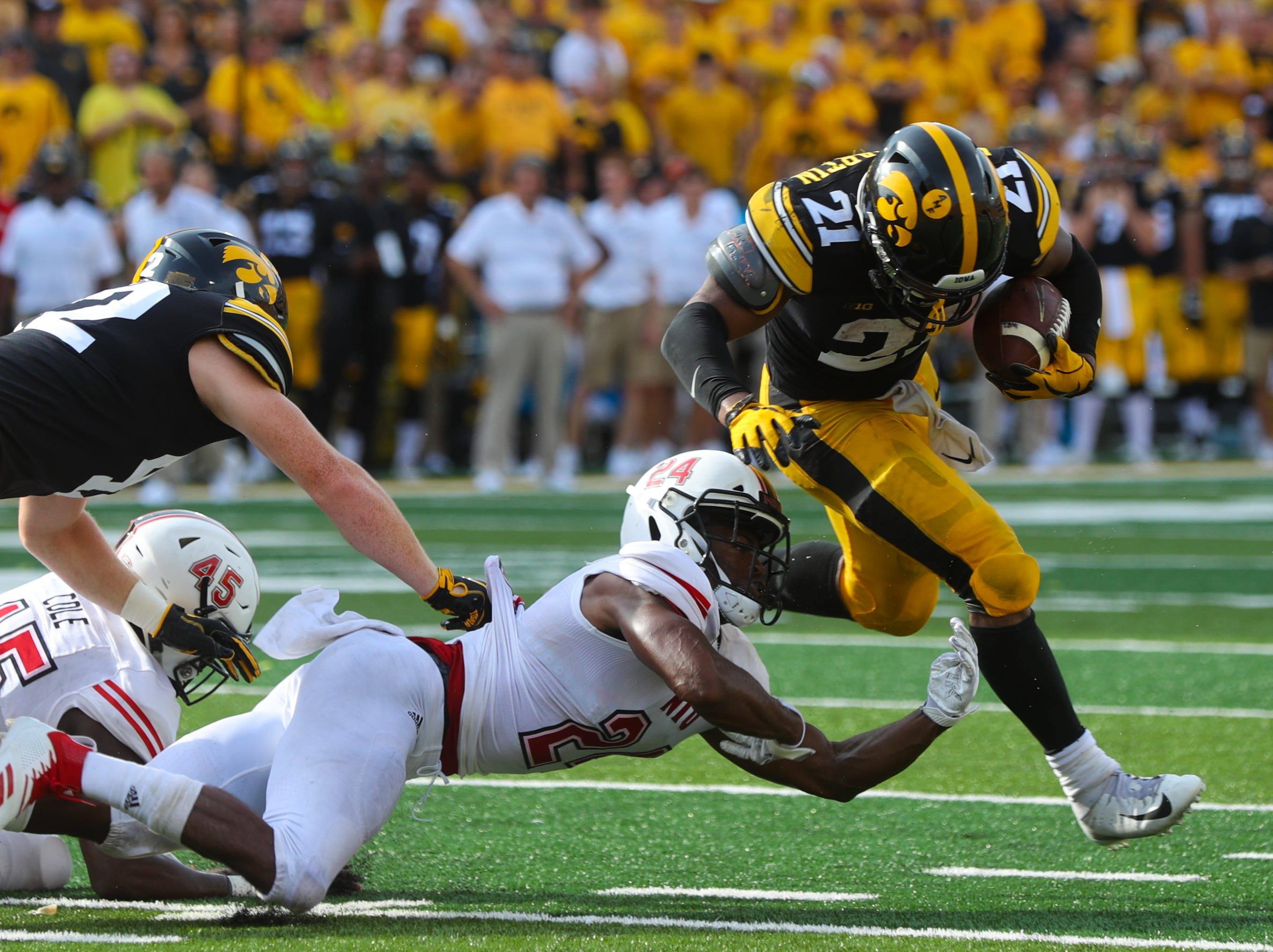 Iowa's Ivory Kelly-Martin breaks away as he runs to the end zone for a touchdown during the Hawkeyes' game against Northern Illinois at Kinnick Stadium on Satuday, Sept. 1, 2018.