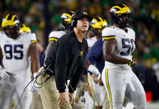 Michigan head coach Jim Harbaugh watches a replay in the first half against Notre Dame in South Bend, Ind., Saturday, Sept. 1, 2018.