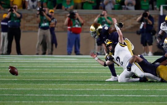 Michigan quarterback Shea Patterson fumbles the ball against Notre Dame in the fourth quarter in South Bend, Ind., Saturday, Sept. 1, 2018. Notre Dame won 24-17.