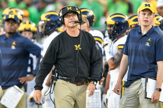 Jim Harbaugh in the first quarter Saturday.