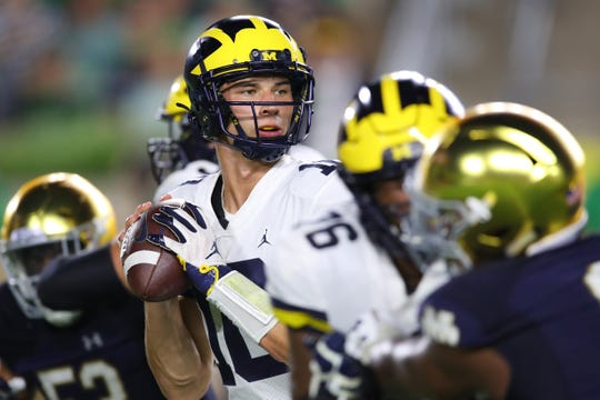 Dylan McCaffrey looks to throw in the second half against Notre Dame.