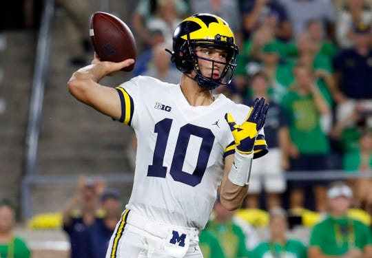 Michigan quarterback Dylan McCaffrey throws in the second half against Notre Dame in South Bend, Ind., Saturday, Sept. 1, 2018. Notre Dame won 24-17.