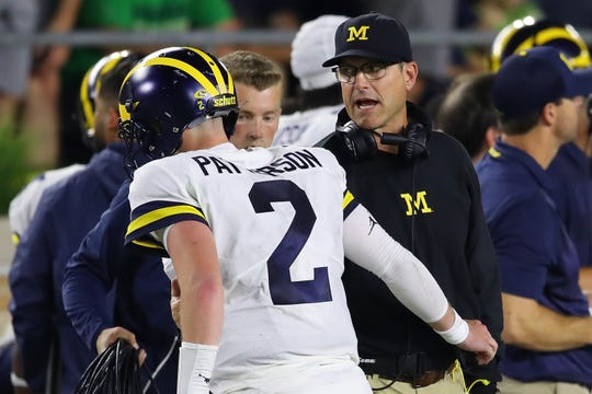 Jim Harbaugh talks to Shea Patterson during the game against Notre Dame.
