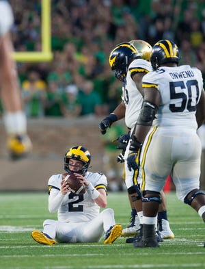Michigan quarterback Shea Patterson (2) sits on the turf after getting sacked for a 17-yard loss in the first quarter.