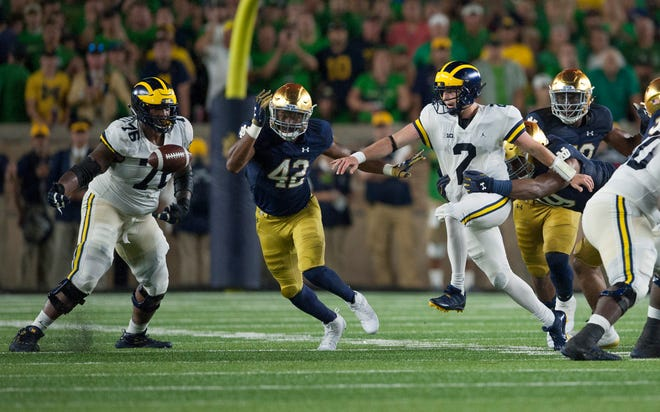 Michigan quarterback Shea Patterson (2) fumbles the ball away to end the Wolverines' final drive and the game with a turnover. Michigan offensive lineman Juwann Bushell-Beatty (76) and Notre Dame defensive lineman Julian Okwara (42) watch the ball come loose.