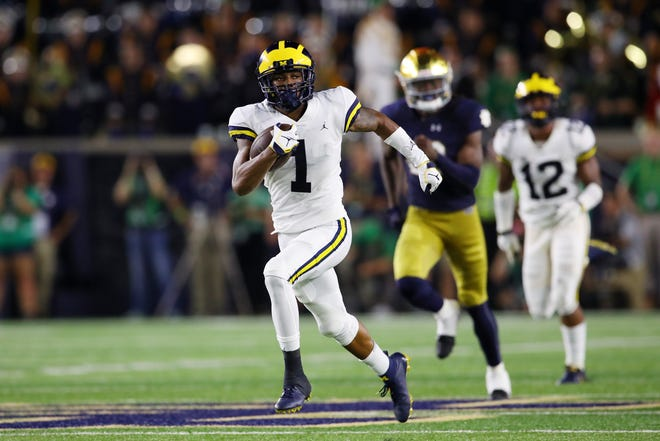 Michigan's Ambry Thomas returns a second quarter kickoff 99 yards for a touchdown.
