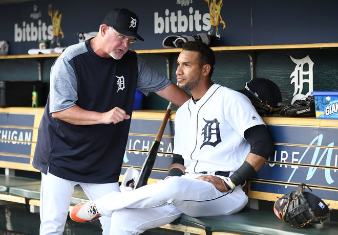 Tigers manager Ron Gardenhire, left, talks with outfielder Victor Reyes during a game earlier this season.