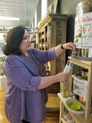You may fill your own bottles of olive oil and vinegar from the fustis at Capers Emporium.